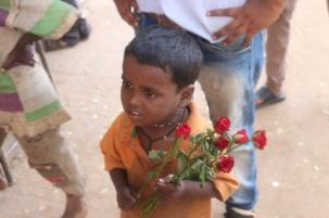 1.1403481600.boy-selling-dead-roses