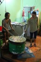 1.1407134640.ladies-making-banh-khot
